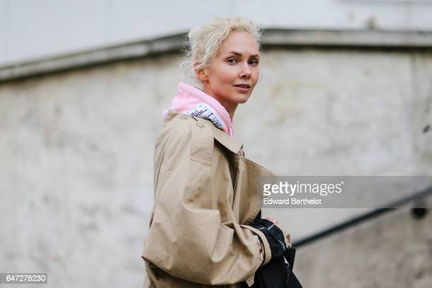 Olga Karput wears a beige coat outside the Paco Rabanne show during Paris Fashion Week Womenswear Fall/Winter 2017/2018 on March 2 2017 in Paris...