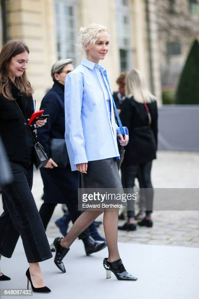 Olga Karput wears a blue striped shirt a black leather skirt and attends the Christian Dior show as part of the Paris Fashion Week Womenswear...