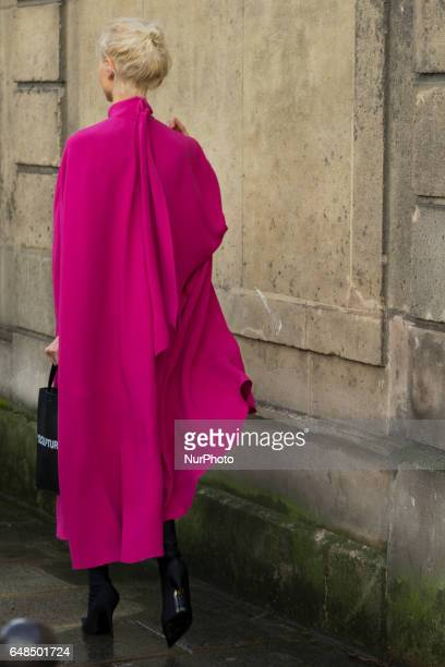 Olga Karput wears a pink dress outside the Valentino show during Paris Fashion Week Womenswear Fall/Winter 2017/2018 on March 5 2017 in Paris France