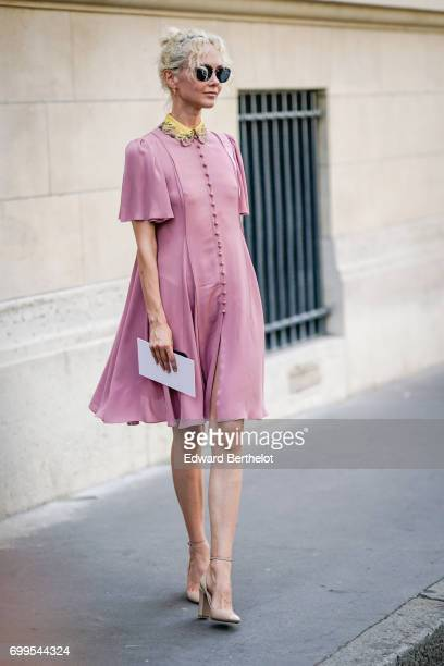 Olga Karput wears a pink dress sunglasses and heels outside the Valentino show during Paris Fashion Week Menswear Spring/Summer 2018 on June 21 2017...