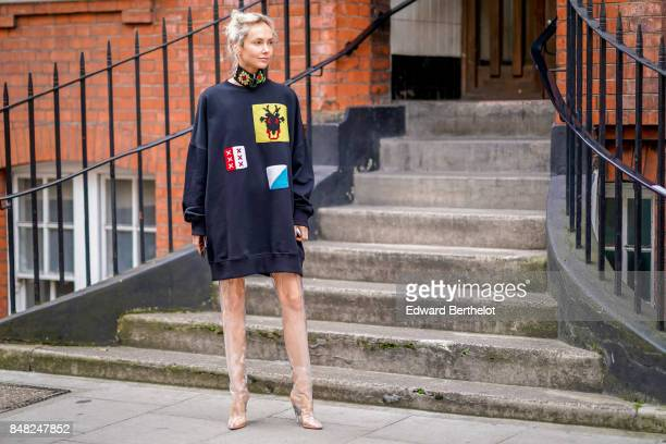 Olga Karput wears an oversized pull over with prints outside JW Anderson during London Fashion Week September 2017 on September 16 2017 in London...