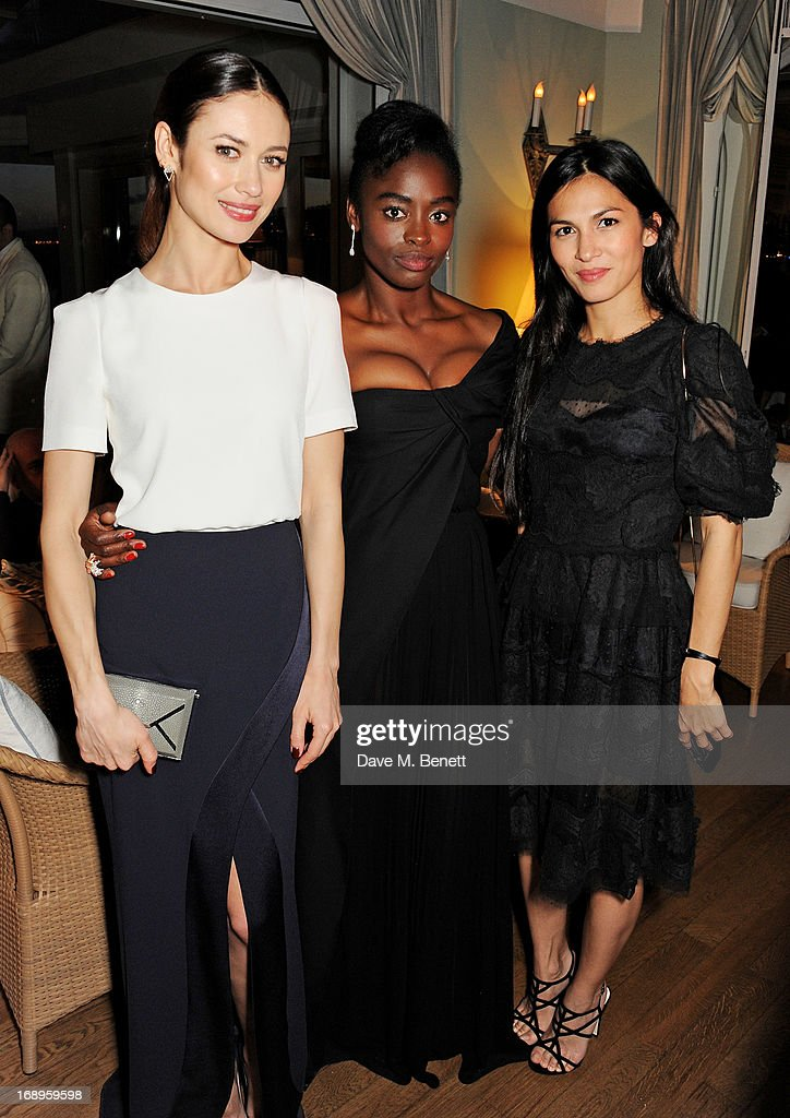 Olga Kurylenko, Aissa Maiga and Elodie Yung attend the annual Finch's Quarterly Review Filmmakers Dinner hosted by Charles Finch, Caroline Scheufele and Nick Foulkes at Hotel Du Cap Eden Roc on May 17, 2013 in Antibes, France.