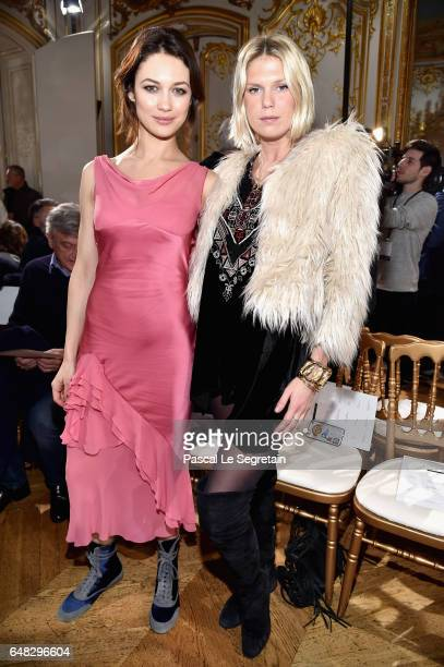 Olga Kurylenko and Alexandra Richards attend the John Galliano show as part of the Paris Fashion Week Womenswear Fall/Winter 2017/2018 on March 5...