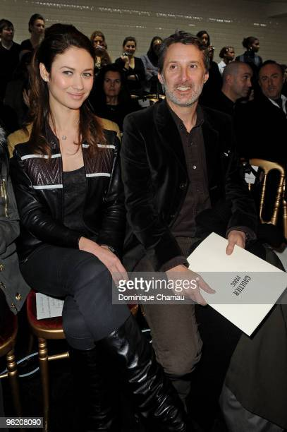 Olga Kurylenko and Antoine De Caunes attend JeanPaul Gaultier Haute Couture fashion show as part of the Paris Fashion Week Haute Couture S/S 2010 on...