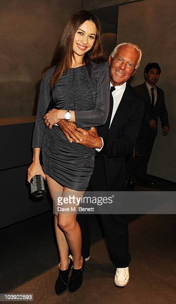 Olga Kurylenko and Giorgio Armani attend Fashion's Night Out At Armani on September 8 2010 in London England