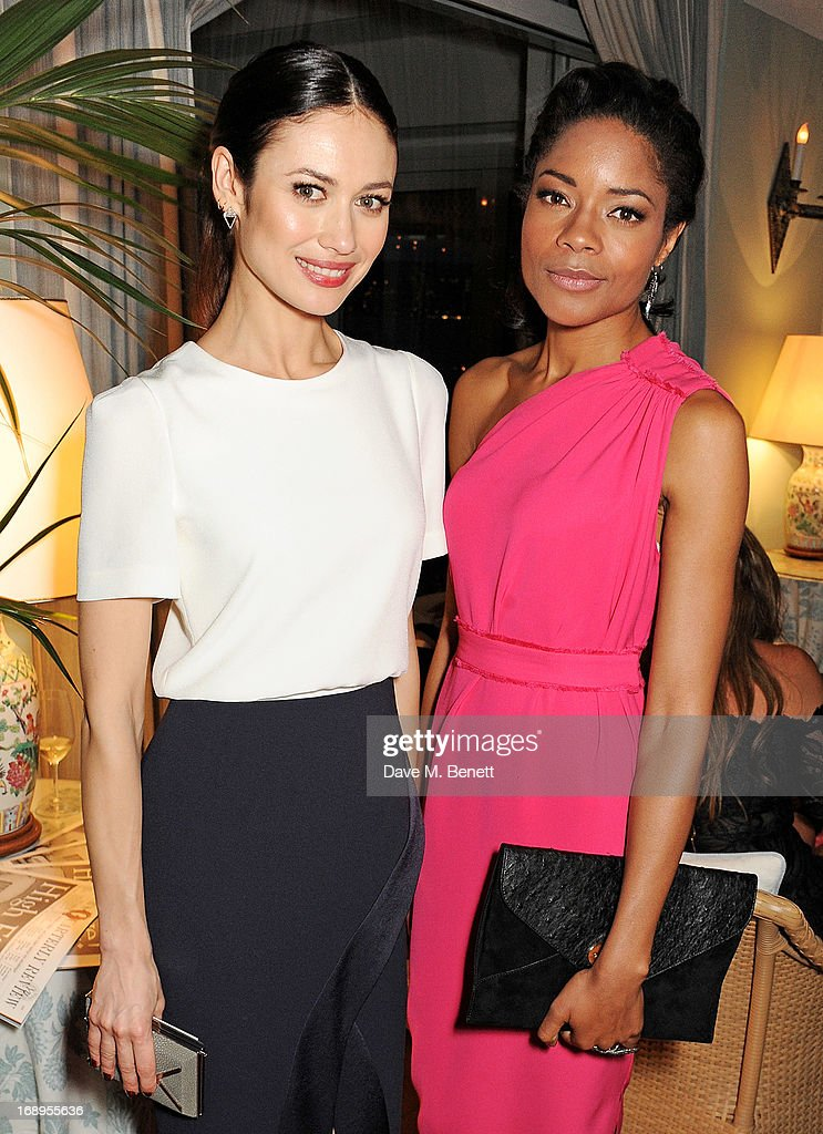 Olga Kurylenko (L) and Naomie Harris attend the annual Finch's Quarterly Review Filmmakers Dinner hosted by Charles Finch, Caroline Scheufele and Nick Foulkes at Hotel Du Cap Eden Roc on May 17, 2013 in Antibes, France.