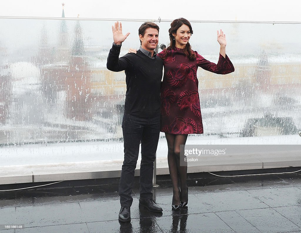 Olga Kurylenko and Tom Cruise attend a photo call of the 'Oblivion' at the Ritz Carlton Hotel on April 1, 2013 in Moscow, Russia.