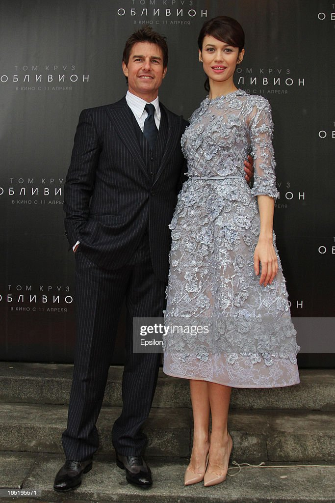 Olga Kurylenko and Tom Cruise attend the film premiere of 'Oblivion' at the Oktyabr cinema hall on April 1, 2013 in Moscow, Russia.