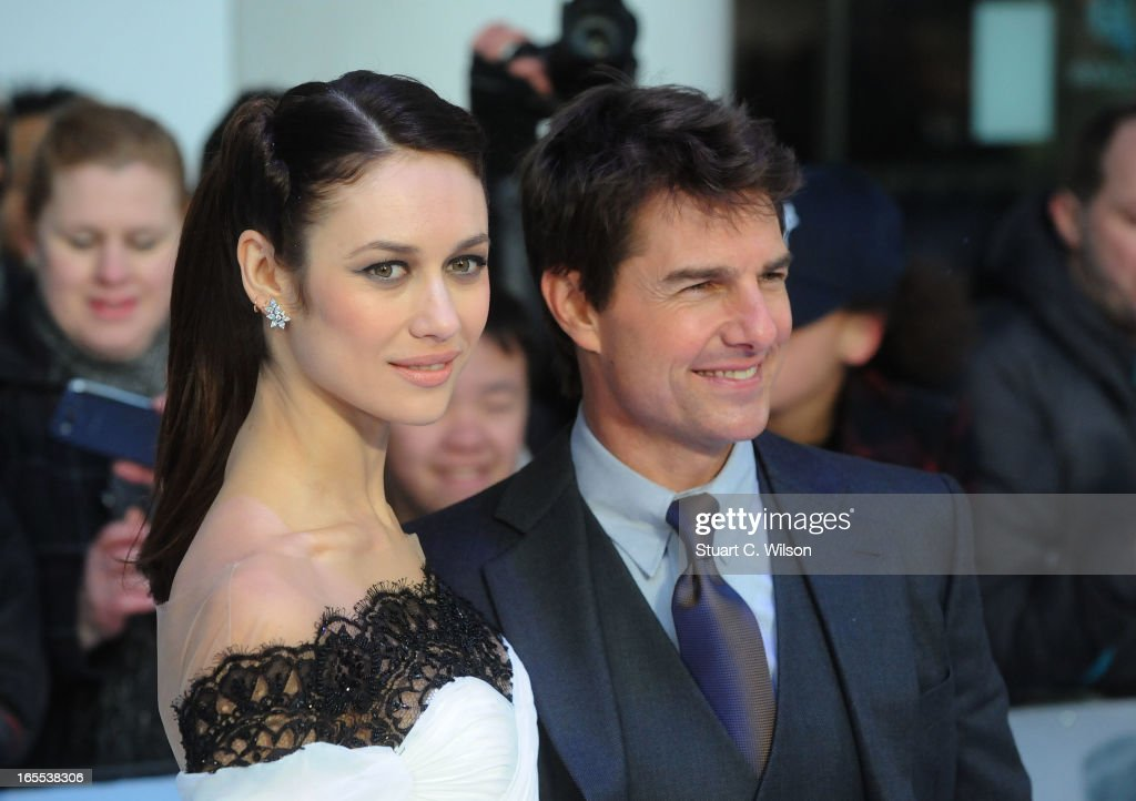 Olga Kurylenko and Tom Cruise attend the UK Premiere of 'Oblivion' at BFI IMAX on April 4, 2013 in London, England.