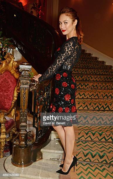 Olga Kurylenko attends the Claridge's Dolce and Gabbana Christmas Tree party at Claridge's Hotel on November 19 2014 in London England