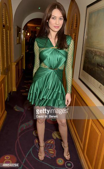 Olga Kurylenko attends the dinner hosted by Olivier Rousteing to mark the opening of Balmain's first London store at Annabel's on March 16 2015 in...
