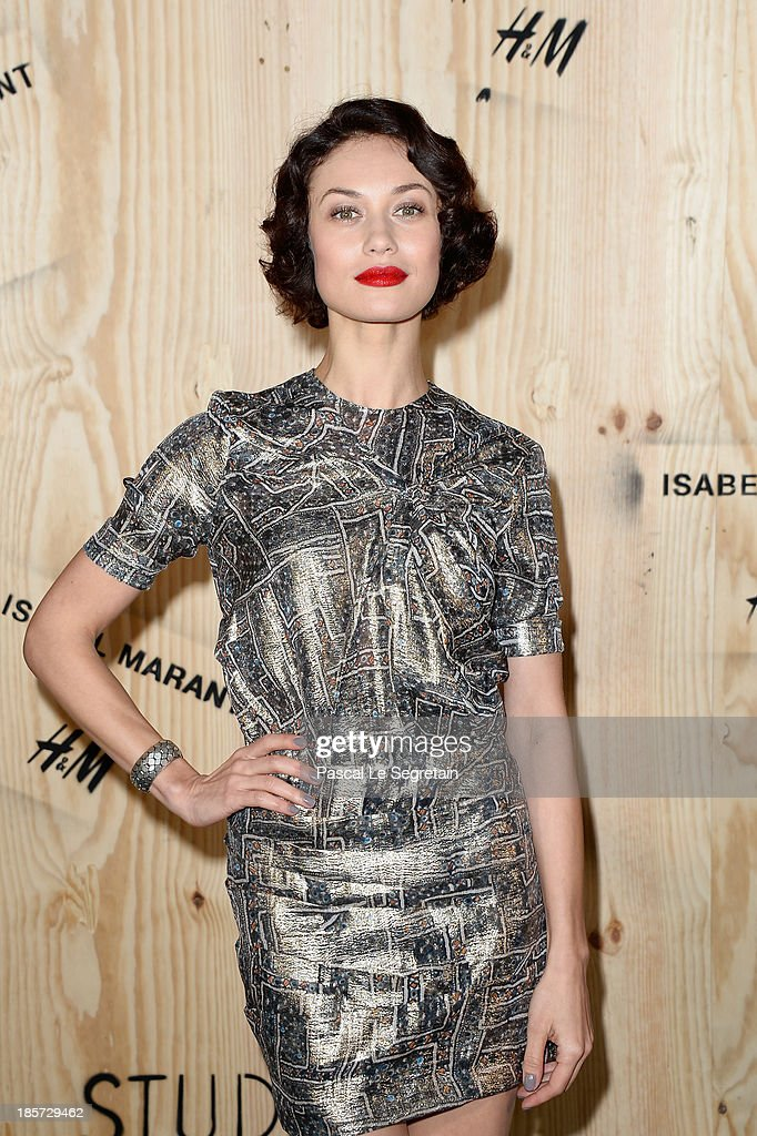 Olga Kurylenko attends the 'Isabel Marant For H&M' Photocall at Tennis Club De Paris on October 24, 2013 in Paris, France.