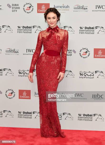 Olga Kurylenko attends the Opening Night Gala of the 14th annual Dubai International Film Festival held at the Madinat Jumeriah Complex on December 6...