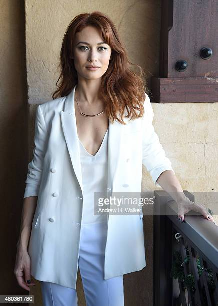 Olga Kurylenko poses during a portrait session on day three of the 11th Annual Dubai International Film Festival held at the Madinat Jumeriah Complex...