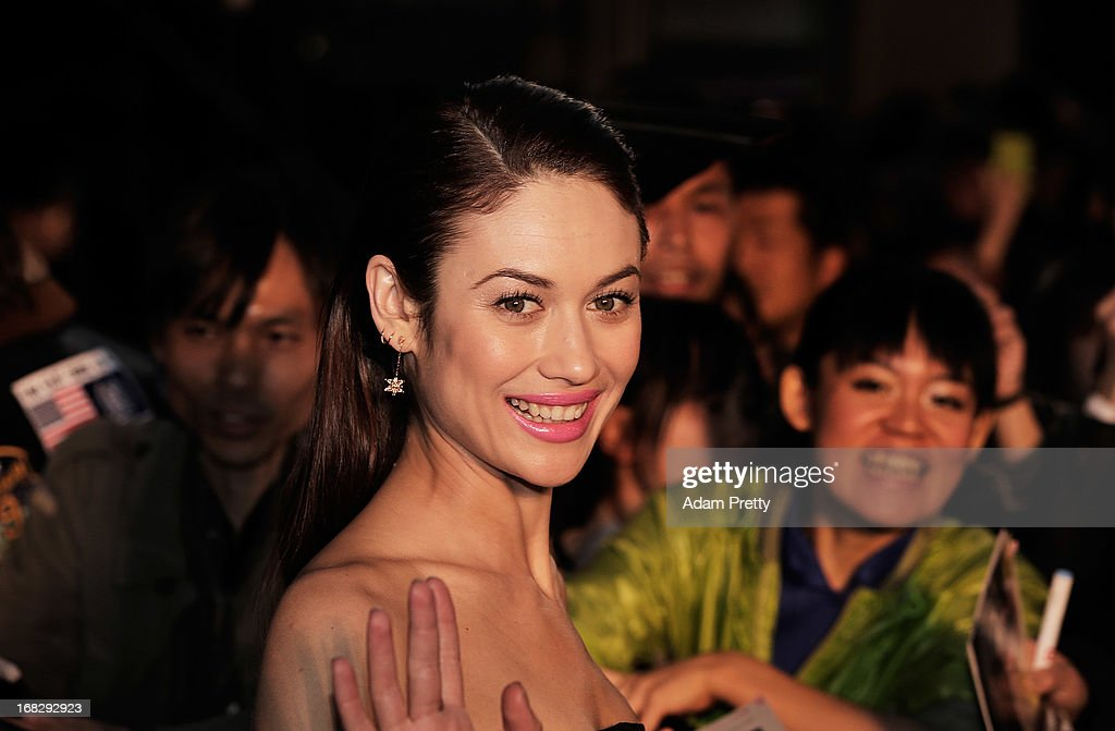 Olga Kurylenko poses for photographs and signs autographs while attending the 'Oblivion' Japan Premiere at Roppongi Hills on May 8, 2013 in Tokyo, Japan. The film will open on May 31 in Japan.