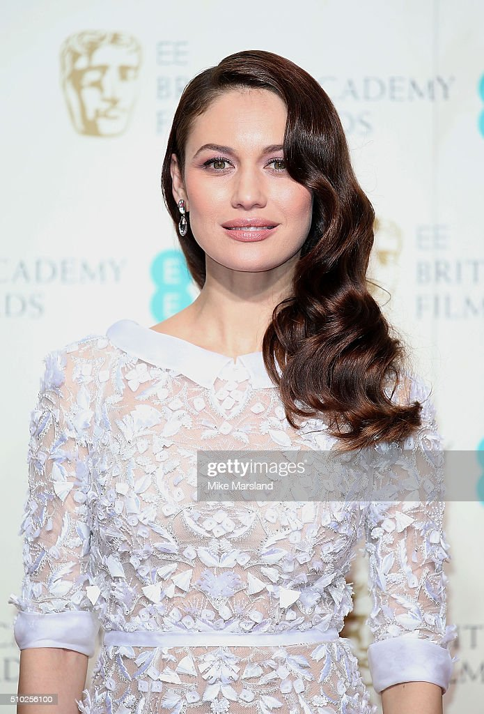 Olga Kurylenko poses in the winners room at the EE British Academy Film Awards at The Royal Opera House on February 14, 2016 in London, England.