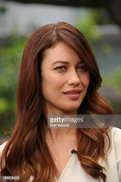 Olga Kurylenko visits 'Extra' at The Grove on June 4 2013 in Los Angeles California