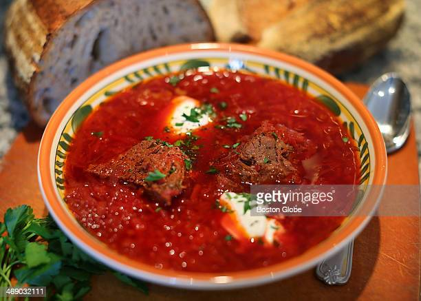 Olga Lisovskaya and her homemade borscht with a fresh loaf of bread her husband made