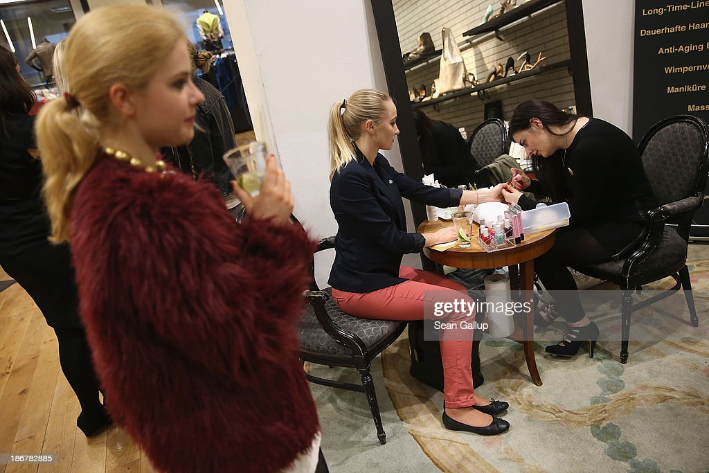 Olga Miller (C), who is orignally from Krasnoyarsk, Russia, and has been living in Berlin for 10 years, has her nails done at the 'Russian Shopping Night' at the F95 fashion store on May 7, 2013 in Berlin, Germany. According to statistics published in October of 2013, 7.2 million foreigners were living in Germany by the end of 2012, which is the highest number ever recorded. Of those 80% are from countries in the European Union, while the rest come primarily from Turkey, Russia, the former Soviet states and Arab countries.