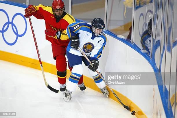 Olga Potapova of Kazakhstan carries the puck during the game against China at the Salt Lake City Olympic Winter Games on February 19 2002 at the...