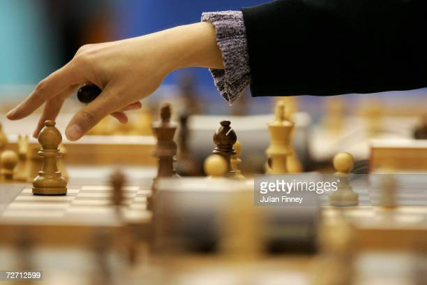 Olga Sabirova of Uzbekistan makes a move in the Women's Rapid Swiss Chess Round 7 match at the Al Dana Indoor Hall during the 15th Asian Games Doha...