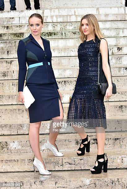 Olga Sorokina and a guest attend the Atelier Versace Haute Couture Fall/Winter 20162017 show as part of Paris Fashion Week on July 3 2016 in Paris...