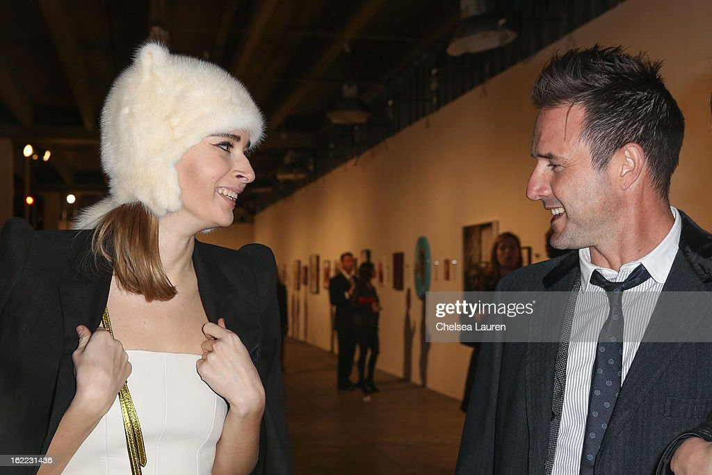 Olga Sorokina (L) and actor David Arquette attend The Art of Elysium gala on February 20, 2013 in Los Angeles, California.