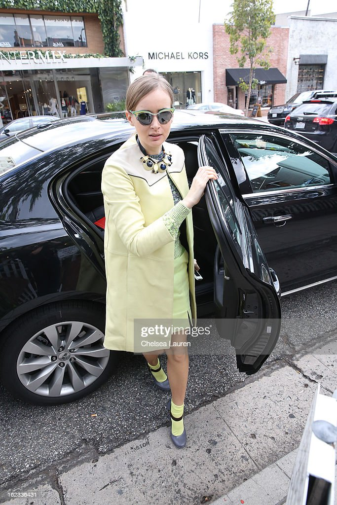 <a gi-track='captionPersonalityLinkClicked' href=/galleries/search?phrase=Olga+Sorokina&family=editorial&specificpeople=8201470 ng-click='$event.stopPropagation()'>Olga Sorokina</a> eats lunch at The Ivy during the Academy Awards week on February 21, 2013 in Los Angeles, California.