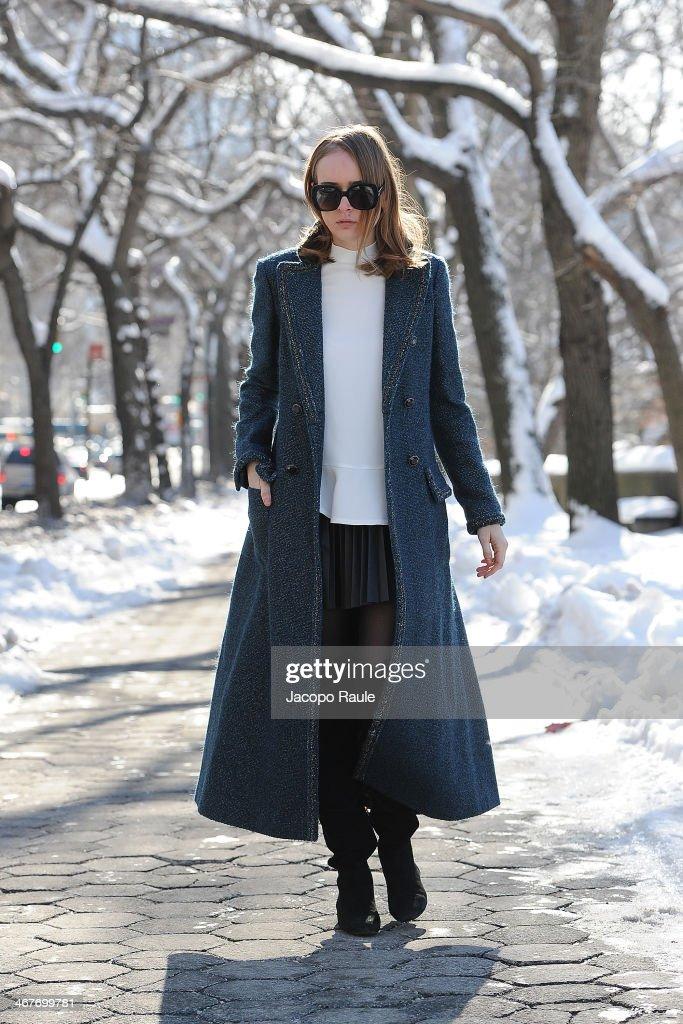 Olga Sorokina is seen around Upper East Side wearing Chanel coat, Stella McCartney top, HM skirt, Alexandre Birman boots and Bottega Veneta sunglasses at Streets of Manhattan on February 7, 2014 in New York City.