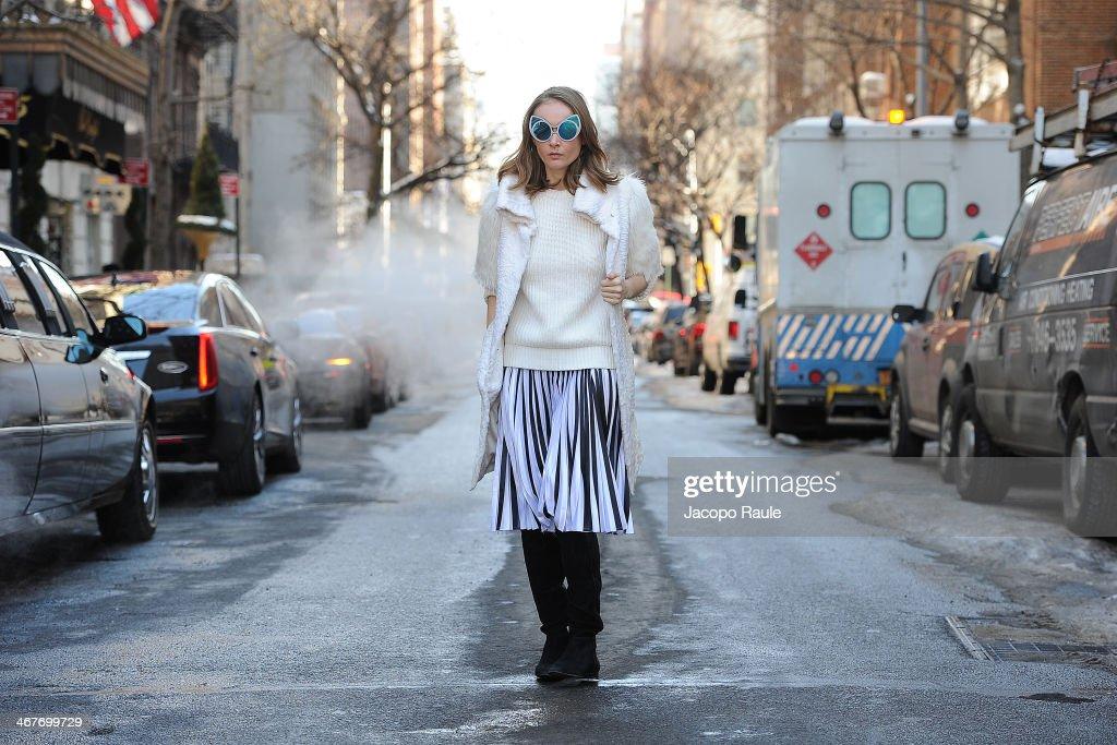 Olga Sorokina is seen around Upper East Side wearing IRFE coat, Michael Kors sweater, Christopher Kane skirt, Khaleda Rajab + Fahad Almarzouq sunglases and Alexandre Birman boots at Streets of Manhattan on February 7, 2014 in New York City.