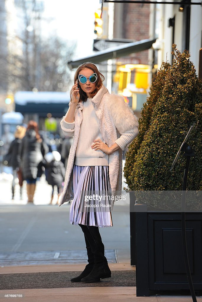 Olga Sorokina is seen around Upper East Side wearing IRFE coat, Michael Kors sweater, Christopher Kane skirt, Khaleda Rajab + Fahad Almarzouq sunglases and Alexandre Birman boots at Streets of Manhattan on February 7, 2014 in New York City.