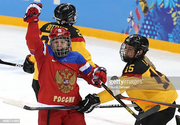 Olga Sosina of Russia celebrates after a goal in the third period against Viona Harrer of Germany during the Women's Ice Hockey Preliminary Round...