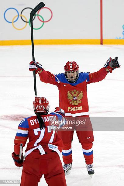 Olga Sosina of Russia celebrates with teammate Inna Dyubanok after scoring a goal in the third period against Viona Harrer of Germany during the...