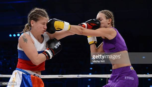 Olga Stavrova of Russia and Christine Theiss of Germany exchange blows during their WKU World Title fight at Oberfrankenhalle on December 13 2013 in...