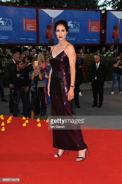 Olga Sutulova poses on the red carpet wearing a JaegerLeCoultre watch during the premiere of the film 'Piuma' at the 73rd Venice Film Festival at at...