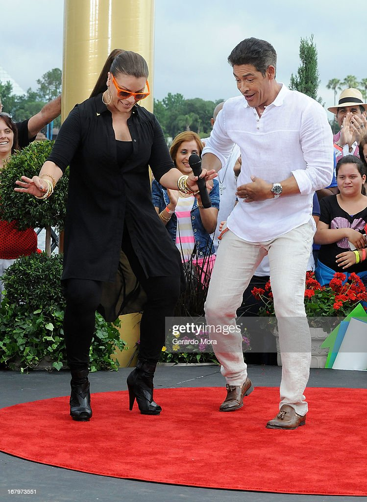 Olga Tanon (L) and Johnny Lozada dance during Univision's morning show Despierta America 16th anniversary at Epcot Center Walt Disney World on May 3, 2013 in Orlando, Florida.