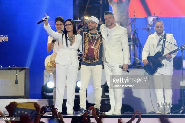 Olga Tanon Nacho and Luis Enrique perform on stage at Telemundo's 2017 'Premios Tu Mundo' at American Airlines Arena on August 24 2017 in Miami...
