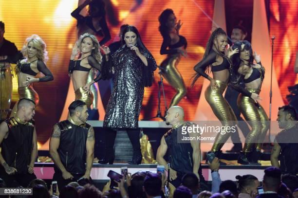 Olga Tanon performs on stage at Telemundo's 2017 'Premios Tu Mundo' at American Airlines Arena on August 24 2017 in Miami Florida