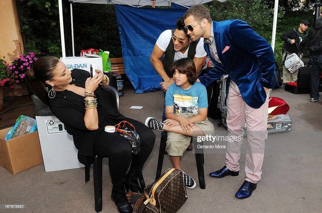 Olga tanon (L), photograph her son Indiana in company of Chino and Nacho during Univision's morning show Despierta America 16th anniversary at Epcot Center Walt Disney World on May 3, 2013 in Orlando, Florida.