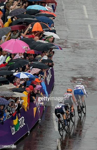 Olga Zabelinskaya of Russia Marianne Vos of The Netherlands and Elizabeth Armitstead of Great Britain pedal into the final stretch during the Women's...