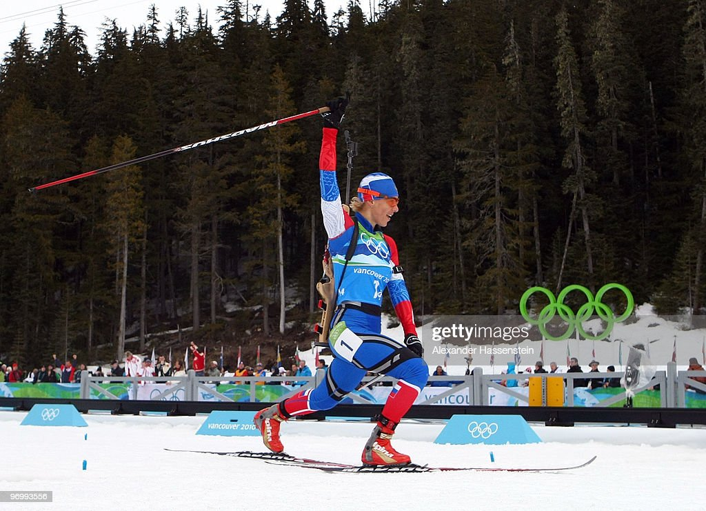 <a gi-track='captionPersonalityLinkClicked' href=/galleries/search?phrase=Olga+Zaitseva&family=editorial&specificpeople=723918 ng-click='$event.stopPropagation()'>Olga Zaitseva</a> of Russia celebrates as she approaches the finish line to win the women's biathlon 4 x 6km relay on day 12 of the 2010 Vancouver Winter Olympics at Whistler Olympic Park Cross-Country Stadium on February 23, 2010 in Whistler, Canada.