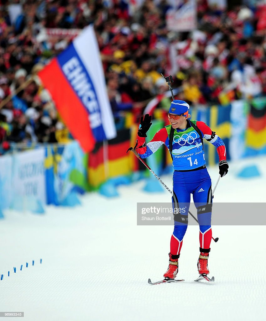 <a gi-track='captionPersonalityLinkClicked' href=/galleries/search?phrase=Olga+Zaitseva&family=editorial&specificpeople=723918 ng-click='$event.stopPropagation()'>Olga Zaitseva</a> of Russia waves to the crowd as she skies to the finish line to win the women's biathlon 4 x 6km relay on day 12 of the 2010 Vancouver Winter Olympics at Whistler Olympic Park Cross-Country Stadium on February 23, 2010 in Whistler, Canada.