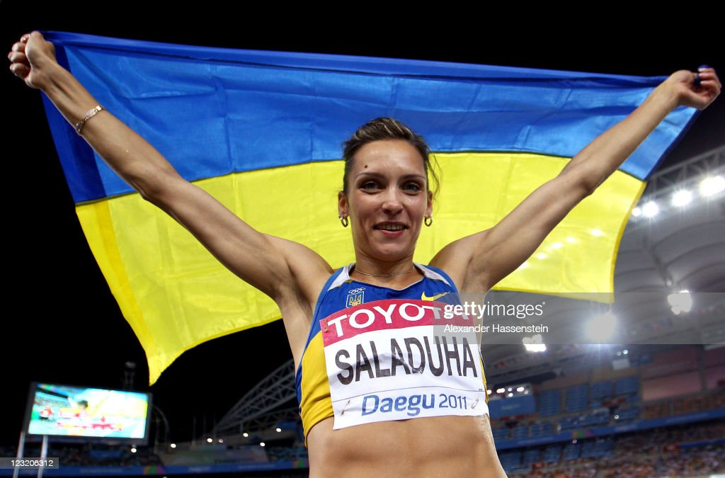 Olha Saladuha of Ukraine celebrates after claiming gold in the women's triple jump final during day six of the 13th IAAF World Athletics Championships at the Daegu Stadium on September 1, 2011 in Daegu, South Korea.