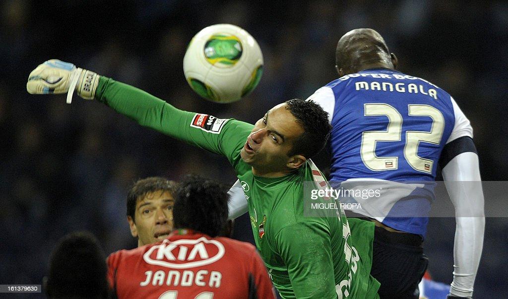 Olhanense's Brazilian goalkeeper Rafael Bracalli (C) jumps for the ball with Porto's defender Eliaquim Mangala during the Portuguese first league football match FC Porto vs Olhanense at the Dragao stadium in Porto, on February 10, 2013.