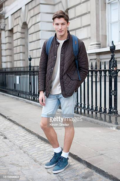 Oli Lacey model wearing Nike trainers Top man cut off jeans Vintage 70s jumper Barbour jacket and a Herschel bag on day 1 of London Fashion Week...