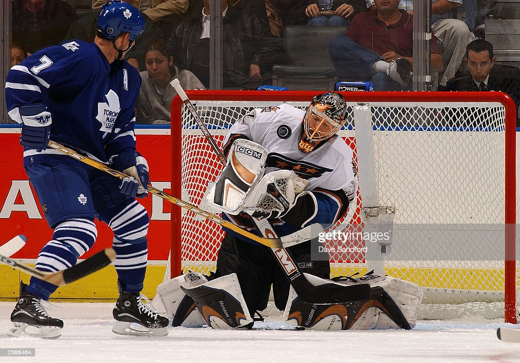 Olie Kolzig #37 of the Washington Capitals makes a save during a as Gary Roberts #7 of the Toronto Maple Leafs looks for a rebound during a Leafs powerplay during a game at Air Canada Centre October 13, 2003 in Toronto, Ontario.