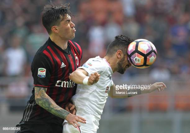 Olija Nestorovski of US Citta di Palermo competes for the ball with Alessio Romagnoli of AC Milan during the Serie A match between AC Milan and US...