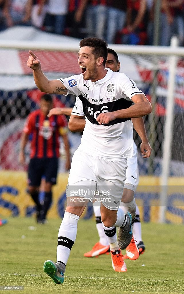 Olimpia's footballer Alejandro Silva celebrates after scoring against Cerro Porteno during Paraguay's Clausura football tournament derby at the...