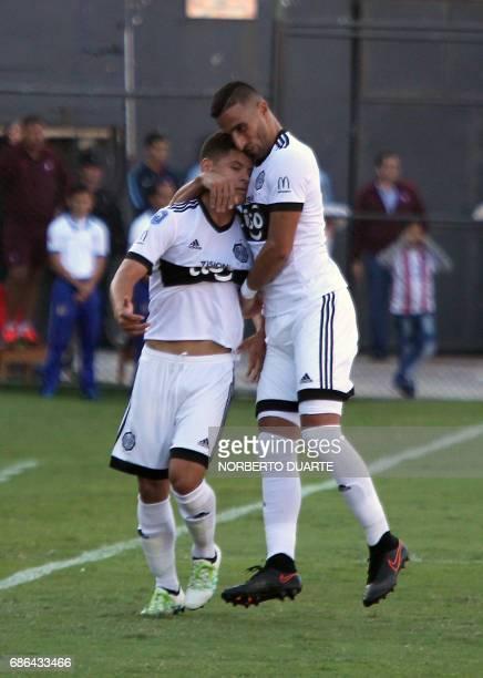 Olimpia's footballer Richar Sanchez celebrates after scoring against Cerro Porteno during their Paraguayan Apertura 2017 tournament match at the...