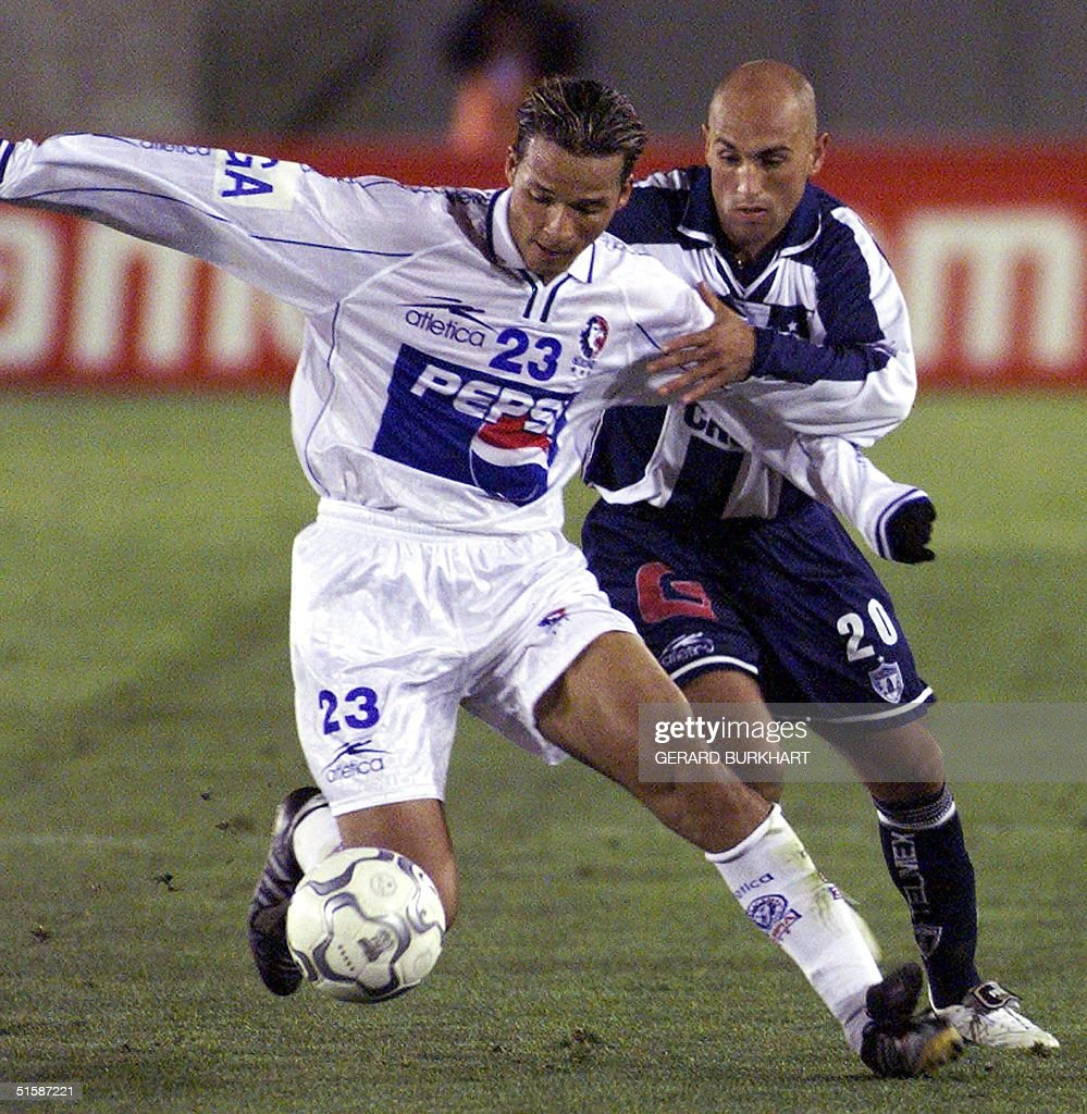 CD Olimpia s Gerson Vasquez L tries to steal the